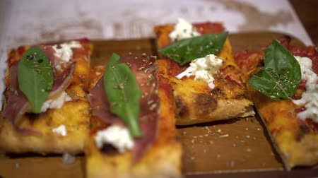 oregano : Square rectangle pizza with cheese and basil rustic meal