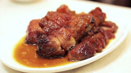 denemek : Chopsticks eating Hong Kong honey barbecue roasted prok