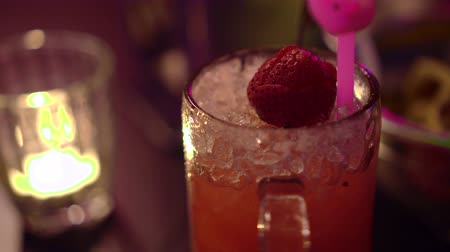cold drinks : Berry cokctail drinks at night bar with candle and neon light Stock Footage