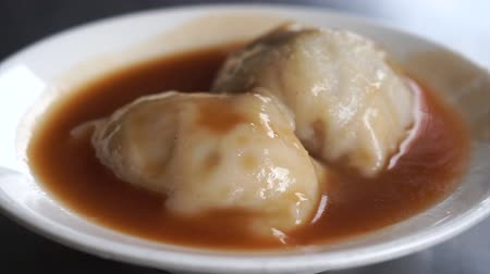 exotic dishes : Chinese steamed dumpling in red sauce