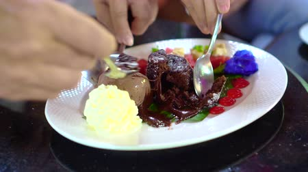 fondant : Sharing eating soft chocolate lava cake with ice cream Stock Footage
