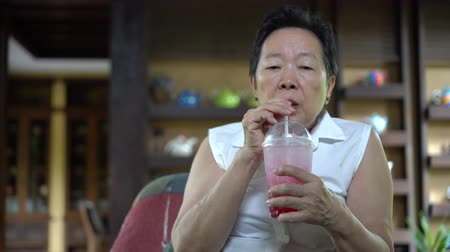 unalom : Asian senior woman lost appetite in Summer heat Stock mozgókép
