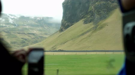 to take : Smart phone taking Iceland landscape view form inside camper van Stock Footage
