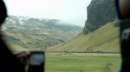 inside bus : Smart phone taking Iceland landscape view form inside camper van Stock Footage