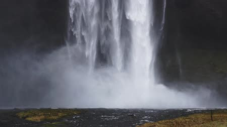 印象的 : Close up strong Iceland fall hitting river in slow motion