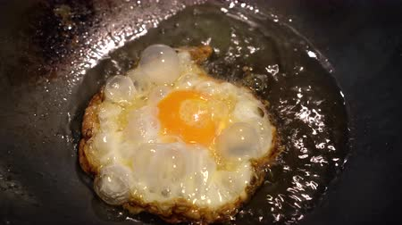 wok food : Sunny side up fried egg in oil Chinese wok Asian cuisine style