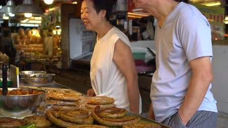 meat rolls : Thai Northern herb sausage in Chiang Mai market Stock Footage