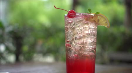 karbonatlı : Summer soda cocktail with lemon and cherry refreshment Stok Video