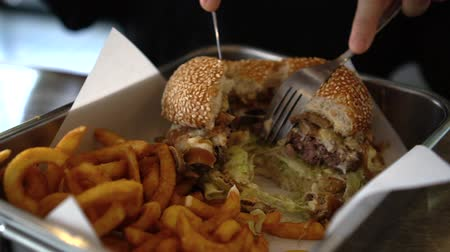 sajtburger : Cutting swiss cheese beef burger mushroom and curly fries in tray