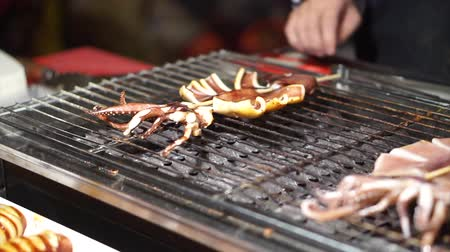 células : Street food grill squid at local market