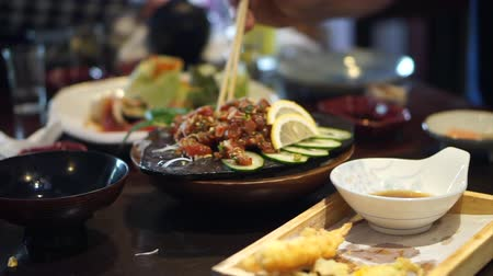 yum yum : Eating spicy salmon salad in Japanese restaurant Stock Footage