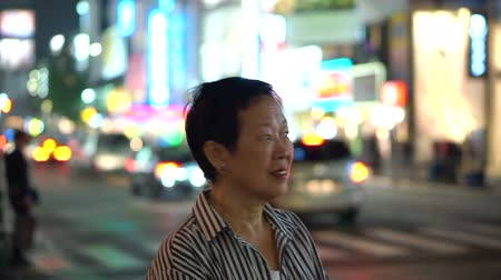 иностранец : Asian elderly woman in Japan blur night light background exploring the world