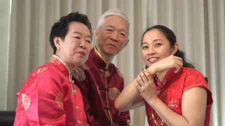 cai : Asian parents give daughter in law gold bracket Chinese New Year