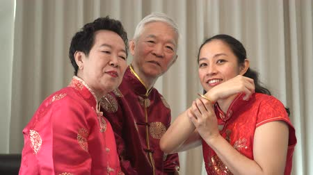 gong : Asian parents give daughter in law gold bracket Chinese New Year