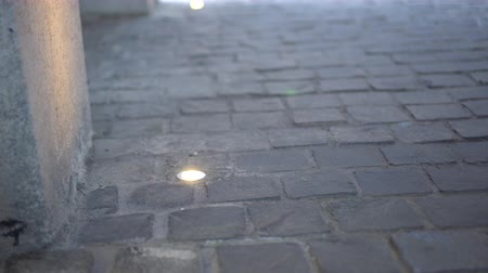 paving : Cobble stone paving floor with in-ground recessed light Stock Footage