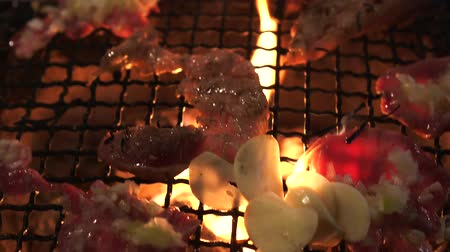 wagyu : Japanese bbq grill beef yakiniku on charcoal and red fire wiht garlic