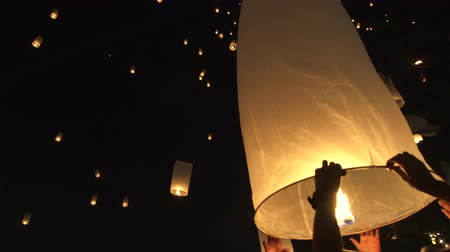 peng : Hand releasing lanterns in festival Chiang Mai Thailand