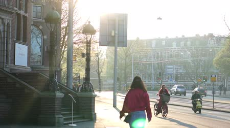 Amsterdam, Netherland - 4 April 2017: morning sun at local city street side walking and biking