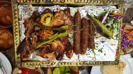 veal recipe : Eating barbecue in Egypt Middle East grill food beef and chicken serve with side dishes