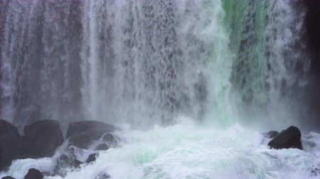 Strong waterfall in Iceland beautiful green color