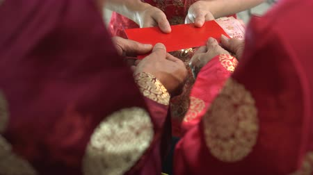 Hands giving Chinese New Year red envelop traditional celebration