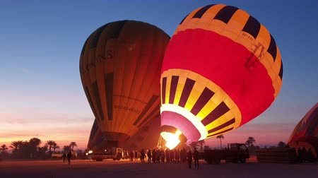 Нил : Luxor, Egypt - 22 Dec 2019 : Hot air balloon inflating advanture tour morning Стоковые видеозаписи