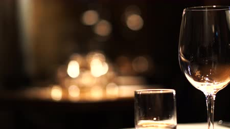 Wine glasses setting in dark luxury restuarant atmosphere