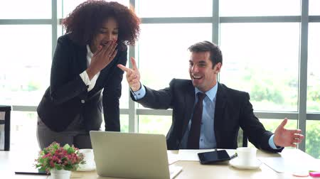 African and Hispanic colleague happy with good news result of work