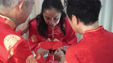 Family giving red envelop Chinese New Year celebration