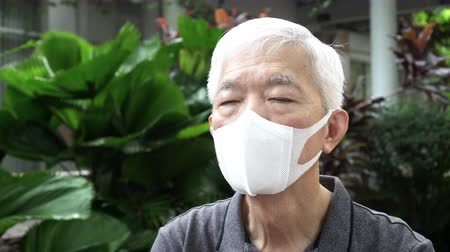 Chinese elderly man wearing mask N95 protect from Coronavirus situation and smog weather Dostupné videozáznamy