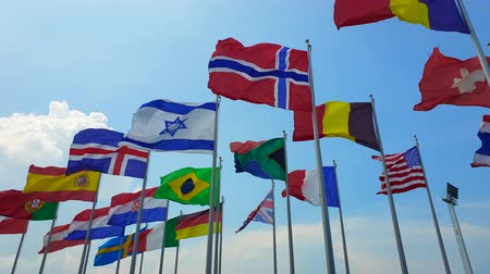 multinational : International colorful national flags sway in outdoor wind abstract of world collaboration