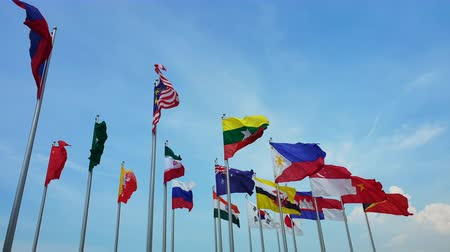 International multi flags pole sway in outdoor wind abstract of world collaboration