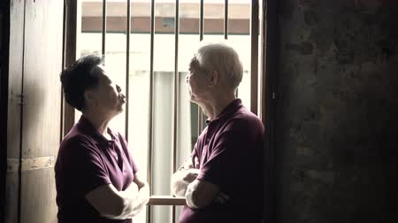 Asian senior elderly couple serious discuss problems next step in life