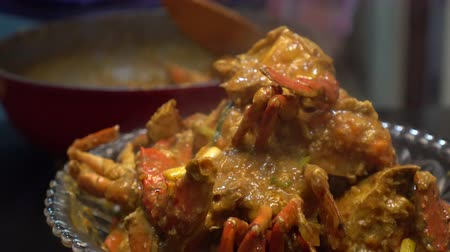 south asian food : Cooking Singapore iconic dish Chilli crab yummy seafood of South East Asia