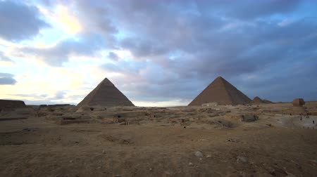 Pyramids of Giza Egypt panorama video view at evening sunset