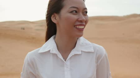 ventoso : Asian woman smile outdoor desert wind blowing hair