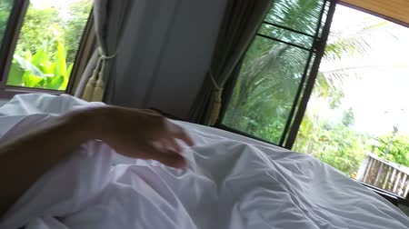point of view pov : POV Of Man Waking Up In Morning Stretching Hands Standing Up From Bed Action Camera View Stock Footage