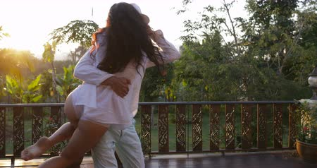 erkély : Young Couple Spinning On Summer Terrace, Happy Man And Woman In Love Embracing Outdoors Over Sunset Landscape Slow Motion 60 Stock mozgókép