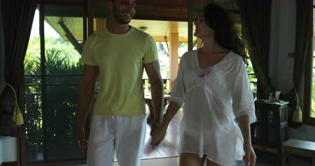 медовый месяц : Young Couple Coming In Home From Summer Terrace Talking, Cheeful Man And Woman Holding Hands Happy Smiling Slow Motion 60
