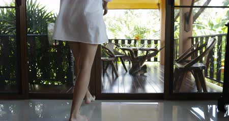 одиноко : Back Rear View Of Woman In White Man Shirt Open Door And Walking Out On Terrace, Attractive Brunette Girl In Morning Slow Motion 60