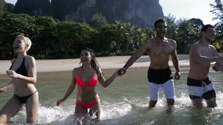 испанец : People Running In Water On Beach In Mountains, Happy Smiling Man And Woman Group Tourists Slow Motion 120