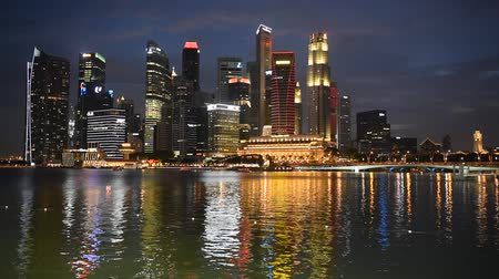 microstock : Singapore, 09 Feb 2016: Beautiful Singapore city skyline with colorful light reflections at Marina Bay. Stock Footage