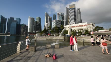 jubileu : Singapore, 26 Feb 2016: Tourists enjoying themsleves at iconic Merlion statue.