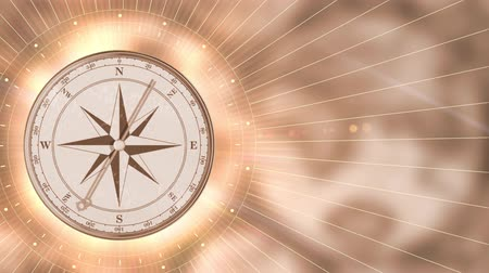 Vintage gold compass on blurred motion background