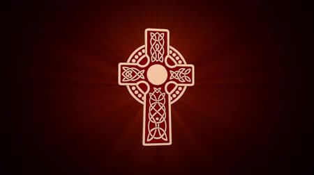 pohanský : Celtic gold cross rotates around an axis on a dark red background. Seamless looping