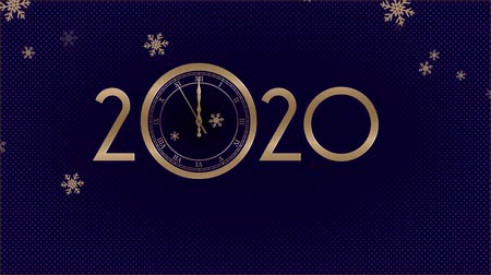 tárcsáz : Happy New Year 2020. Last 10 seconds to 12 oclock. Snowflakes falls. 4K stock footage