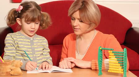 abacus : little girl working her homework and making a mistake