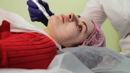 mezoterapia : The girl during the procedure bb glow. Face close up. Rejuvenation of the skin. Innovative technologies Wideo