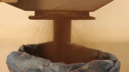 mashing : Grinding of malt for producing beer at the brewery. Ground malt pours from the mill into the bag Stock Footage