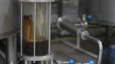 distillation : Craft beer brewing. Filtration of brewed beer. Brewing equipment in action. Close-up
